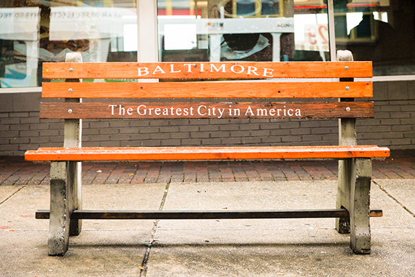 """Wooden bench in Baltimore (USA) showing a text : """"Baltimore, The Greatest City in America"""""""